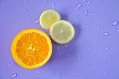 Half of Fresh Orange and Lemon Pieces on Background royalty free stock image