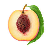 Half of fresh peach. Isolated on white stock photography