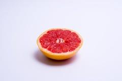 Half a fresh red grapefruit on white background. Half a fresh red grapefruit on a white background Stock Image