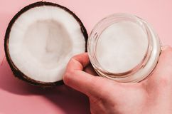 Ripe coconut fruit and coconut oil royalty free stock photography