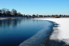 Half Frozen Lake, Bremen, Germany. Due to winter and current water the lake is half frozen. Lake is called Werdersee in Bremen, Germany, Europe. It is a Royalty Free Stock Photo