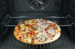 Half frozen pizza Stock Image
