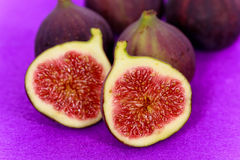 Half of the fruit of fig , on the purple backgroun Royalty Free Stock Photo