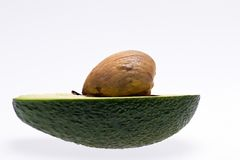 Half of fruit of fresh avocado with stone isolated on white background Royalty Free Stock Images