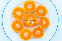 Half fruit orange on a white plate. Stock Photography