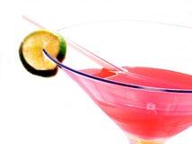 Half Full. Metaphor, A half full glass of a pink margarita,over white Stock Image