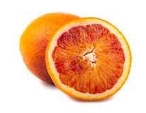 Half and full bloody red oranges Royalty Free Stock Photography
