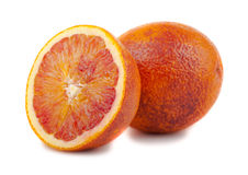 Half and full bloody red oranges Royalty Free Stock Image