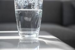 Half Full Glass Cup on Marble Table Royalty Free Stock Photography