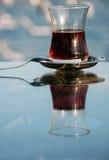 A (half full) glass of tea Stock Photos