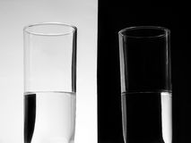 Half full - Half empty. Two glasses representing the idea of optimism versus pessimism.You can see the glasses as being half full or half empty Stock Photo