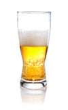 Half glass of beer on a. White background royalty free stock photography