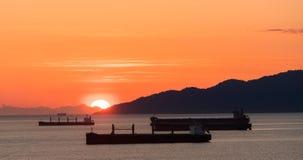 Half Golden sunset over the ocean Stock Photos