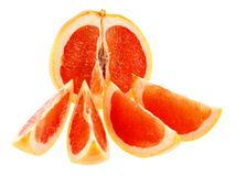 Half of grapefruit with four slices. Stock Images