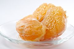Half of grapefruit on a glass plate Stock Image