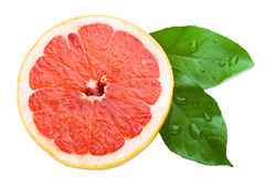 Half a grapefruit with leaves on a white background Royalty Free Stock Images