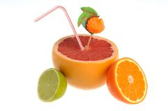 Half of grapefruit, lime, orange with cocktail tube and decorati Stock Photo