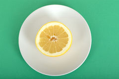 Half a Grapefruit on a Plate Stock Photography