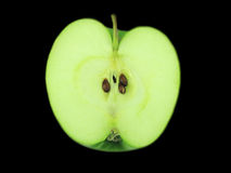 Half of the green apple. Stock Image