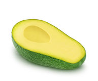 Half of green avocado isolated on a white Stock Images