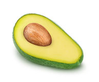 Half of green avocado with seed isolated on a white Stock Images