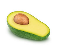 Half of green avocado with seed isolated on a white Stock Photos