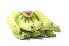 Half green half yellow bananas with some stains taken on white s. Creen, good for food content royalty free stock photo