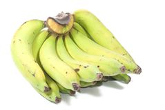 Half green half yellow bananas with some stains taken on white s. Creen, good for food content royalty free stock photos