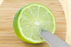 Half  Green Lime  Fruit Knife  Cutting Board Stock Photo
