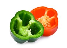 Half of green and red sweet bell pepper or capsicum isolated. On white background royalty free stock photo
