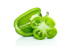 Half of green sweet pepper and flower-shaped slice Royalty Free Stock Images