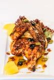 Half grilled chicken stock photos