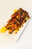 Half grilled chicken stock image
