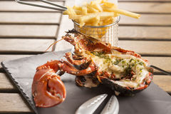 Half Grilled Lobster. With herb butter & fries royalty free stock photography