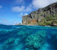 Half and half coastal cliff and rocks underwater Stock Photo