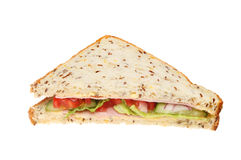 Half ham salad sandwich. Half of a ham salad sandwich with soya and linseed bread isolated against white Stock Photography