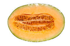 Half hamigua melon is wrapped by plastic film for protection iso Royalty Free Stock Image