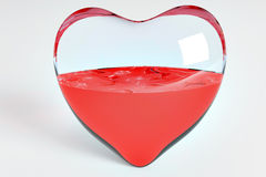 Half heart. Red transparent glass heart half full Stock Photography