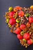 Half heart. Heart-shaped flower arrangement on dark background royalty free stock photography