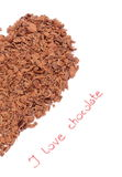 Half of heart from grated chocolate on white background Royalty Free Stock Images