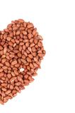 Half of heart from peanuts. Stock Photos