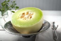 Half of Honey Dew melon in a bowl Stock Photos