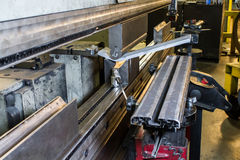 Half inch steel being bent in press Royalty Free Stock Photos