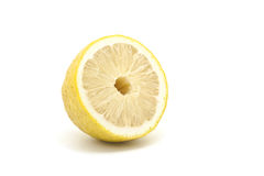 Half Japanese lemon isolated on white background Royalty Free Stock Photo