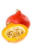 Half Japanese Squash. Red kuri squash, small pumpkin with a halved one isolated over a white background Stock Images