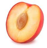 Half of juicy red plum  Stock Photos