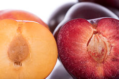 Half juicy yellow and cherry plums. Closeup Stock Photography