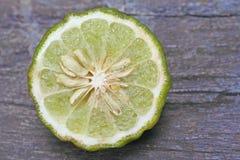 Half of kaffir lime bergamot. Close up Half of kaffir lime bergamot royalty free stock image