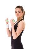 half kilo för attraktiv övningskvinnlig genom att använda vikter arkivfoton