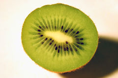 Half kiwi. Sliced fresh kiwi fruit close-up royalty free stock photo